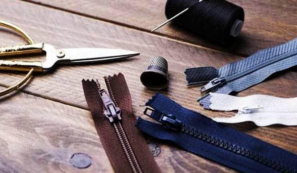 como coser un cierre